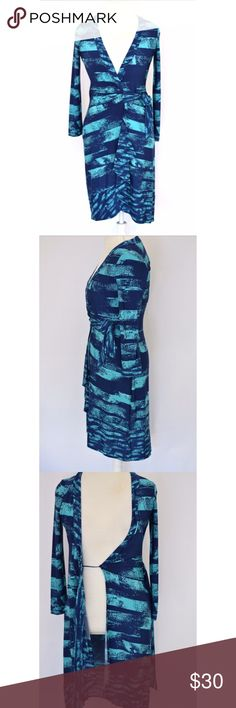 Gorgeous BCBG watercolor dress XS Like new.  No flaws.  Perfect for all occasions (except perhaps yardwork).  Look chic in less than 2 minutes with this stunning and comfy wrap dress.  Watercolor blue.  Contrasting hemline.  Flawless.  Offers welcomed BCBG Dresses