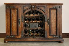 Al Fresco hand painted wine cabinet at Accents of Salado. We ship hand painted furniture nationwide.