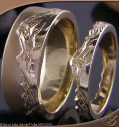 14k Yellow Gold Hand Carved Mountain and Wave Bands. I'd love to get Mt Rainier