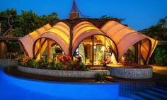 The stunning Onion House in Kona, Hawaii is a prime example of renowned architect Kendrick Kellogg's visionary style.
