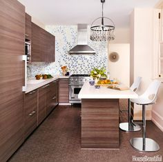 Caroline Beaupère designed a custom-made tile backsplash of delicate vines to bring a New York City kitchen to life.