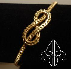 Wire Weaving Infinity Knot Bracelet by JewelByJennifer on Etsy