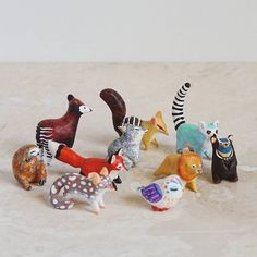 AUCTION IS OVER! Instant collection of TEN mini animal sculptures: okapi, numbat, ring-tailed lemur, red fox, wolf, lion, bear, sloth, quoll & owl. THESE ARE NOT CERAMIC. They're air dry paper clay decorated with acrylic and sealed with a matte varnish.