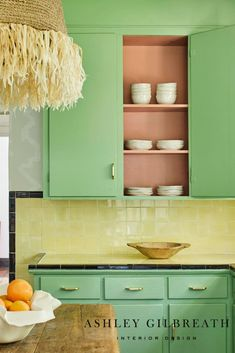 ASHLEY GILBREATH INTERIOR DESIGN: The original green cabinet color was updated with brass pulls to modernize this Montgomery cottage kitchen! Original yellow and black countertops provide a fun contrast to the green cabinetry. Tile Counters, Backsplash, Black Countertops, Ashley Gilbreath, Kitchen Dining, Kitchen Cabinets, Green Cabinets, Creative Outlet, Paint Cans