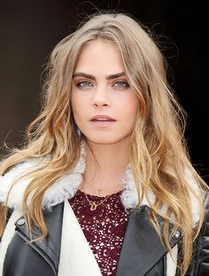 Cara Delevingne with bold brows and light pink lip