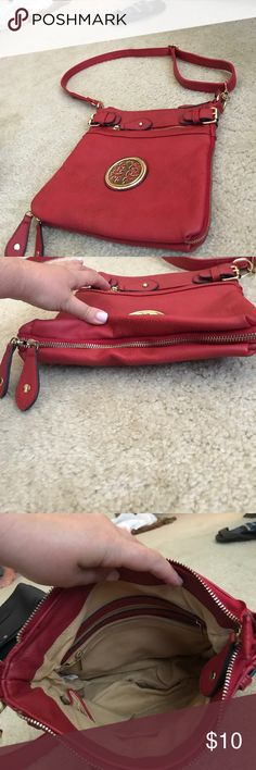 Imitation Tory Burch Crossbody bag Beautiful red Crossbody bag with adjustable strap and gold hardware. Gold emblem on front, adjustable zipper detail on bottom on bag. Zipper pockets inside and on back. Bags Crossbody Bags