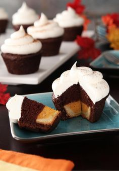 """Mini Chocolate-Pumpkin """"Pie Cakes"""" – These mini desserts look impressive, with their COOL WHIP frosting and their ground cinnamon garnish. Little will your holiday guests know that the recipe only took you 20 minutes of prep!"""