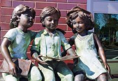 Three Children Reading - a cast bronze sculpture designed by Randolph Rose of Yonkers, New York.