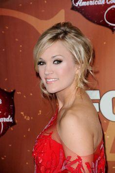 Carrie Underwoods low, side-swept updo