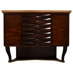 Osvaldo Borsani Attributed Rosewood Dry Bar Cabinet | From a unique collection of antique and modern dry bars at https://www.1stdibs.com/furniture/storage-case-pieces/dry-bars/
