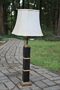 You might want to grab a cheap solar light at Lowe's when you see this woman's stunning yard lighting idea: