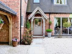 The English Porch Company produce beautiful bespoke and traditional wooden porches, porch kits, porch frames, oak framed porches and canopy porches in the UK. Cottage Front Doors, Front Door Porch, Cottage Porch, Cottage Exterior, Cottage Homes, Cottage Style, Porch Oak, Porch Entrance, Side Porch