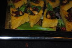 polenta triangles with roasted pine nuts and sun-dried tomatoes, a great vegetarian entertainment idea!