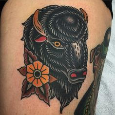 Fun buffalo tattoo on Erin's leg