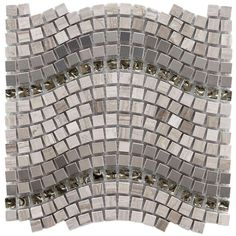 The pattern of this mosaic tile features a beautiful wave motion, created using glass, metal, and stone tiles. Would you use this tile in your next bathroom renovation or kitchen update? #tile
