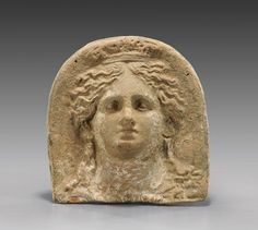 Greek antefix, Tarantine terracotta antefix, 4th century B.C. Depicting bust of a goddess, with flowing hair, and a topknot bound by a diadem, 22 cm high. Private collection, from Artemis gallery