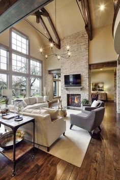 """""""View this Great Rustic Living Room with Pendant Light & Columns by Bill Bisset. Discover & browse thousands of other home design ideas on Zillow Digs."""""""