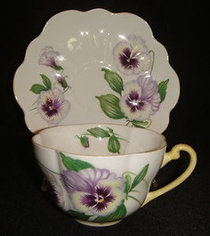 Beautiful Shelley Pansy tea cup and saucer in the Warwick shape ~ pattern #13823. Shelley is something I love to collect and is among some of the most collectable types of china. Beautiful, surprisingly thin and yet strong translucent bone china, Shelley tea cups come in a huge variety of shapes and patterns including chintz, floral, and art deco. Foley/Shelley China was made from 1860 to 1966 and was probably the zenith in English china manufacturing.