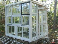 A green house made from old windows