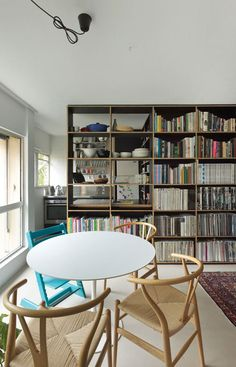 Potts Point Apartment by Anthony Gill Architects - I like Ychairs and bookschelves!!!!
