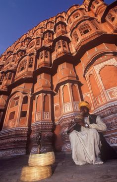 """Your Essential Guide to Visiting the """"Pink City"""" of Jaipur: Snake charmer outside the Palace of the Winds, Jaipur."""