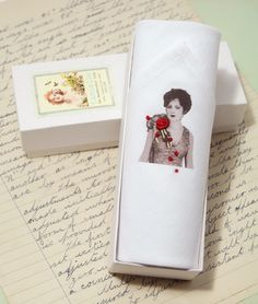 A beautifully soft single hankie printed with a vintage lady wearing a hand embroidered brooch.