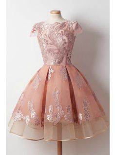 Silhouette:a-line Hemline:knee length Neckline:scoop Fabric:tulle Sleeve Style:cap sleeve Color:pink Back Style:zipper up Embellishment:appliques
