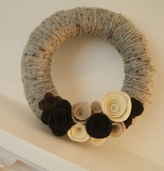 Neutral Yarn Wreath  Don't always like these but this on is kind of ocol the yarn gives it depth and the colors are cool.