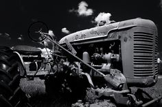 Black and white fine art photograph of a rusty and abandoned Farmall tractor. The chipped paint and patina lend the Farmall a lot of character. Chipped Paint, Farmall Tractors, Black And White Photography, Fine Art Photography, Abandoned, Monster Trucks, Photographs, Wall Art, Painting