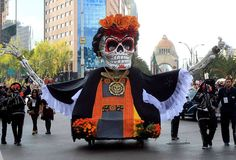 Mexico City holds its first Day of the Dead parade with floats, giant skeleton and more than 1,000 actors, dancers and acrobats in costumes.