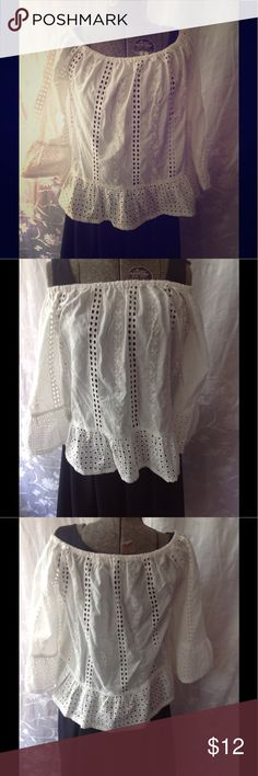 White eyelet off the shoulder blouse by Solitaire Beautiful summer off the shoulder blouse by Solitaire in a size M. It is in perfect used condition. You can wear the shoulder up or off the shoulder. Nice flounce detail on the sleeve. solitaire Tops Blouses