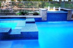 Here is blue iridescent glass tiles that help to form the spa spill over and…