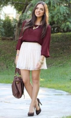 flowy long sleeved tee tucked in with statement necklace
