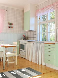Love curtains in place of cabinet doors to add color and softness.
