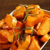 Maple-Roasted Sweet Potatoes & Broccoli With Caramelized Onions and Pine Nuts