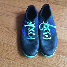 Athletic soccer indoor Nike shoes Athletic Nike indoor soccer shoes. Women's US size 9.5. Black base with mint colored shoe strings and outer sole. Royal blue print with black Nike swoosh. Great tread. Lightly worn and in top condition. Nike Shoes Sneakers