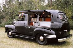 Not a hearse or ambulance, but it is still an awesome commercial vehicle that would have been customized by a coach company. 1949 bookmobile. How fantastic that someone found this and restored it.