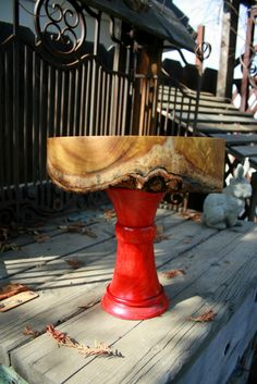 Cake Stand.  Each piece is a solid piece of wood, turned on a wood lathe.  The top piece is bark on the underside.
