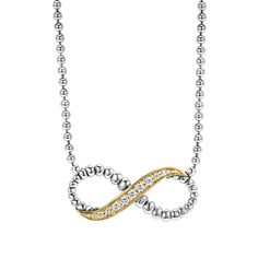 Diamond infinity pendant with sterling silver infinity motif accents on a sterling silver ballchain necklace that adjusts from 16 to 18 inches. Finished with a lobster clasp. LAGOS diamonds are the highest quality natural stones.