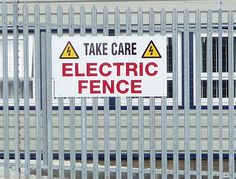 Electric fence warning sign on perimeter fence to deter intruders. Perimeter Security, Warning Signs, Survival Prepping, Car Parking, Fence, Electric Fencing, Shtf, Grid, News