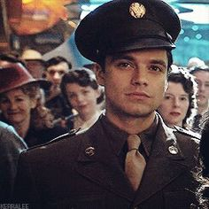 "((FC Sebastian Stan)) ""Hello, I'm James Barnes, but you can call me Bucky. I'm 21 and I've been serving for a couple years, and it's usually my job to show new recruits the basics of base camp and war. Introduce?"