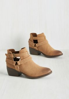By strolling around town in these tan booties from BC Footwear, you're perfectly outfitted for a fashionable frolic! Featuring buckles, vented sides, and straps that converge at a circular metal accent, this vegan faux-leather pair makes your prance a memorable one!