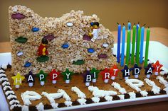 """Rock climbing wall cookie cake.  """"Wall"""" is a rice crispy treat and she used Wilton melts for the lego hand-holds"""