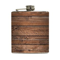 You never know when you might need to BYOB. Carry around your spirits in this stainless steel flask adorned with a rustic, barn-wood image printed on high-quality vinyl or give it as a gift—this charmi...  Find the Handmade Wood-Print Flask, as seen in the The Modern Outdoorsman Collection at http://dotandbo.com/collections/the-modern-outdoorsman?utm_source=pinterest&utm_medium=organic&db_sku=LQC0003