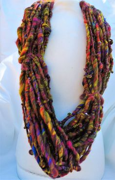 Hand spun art yarn thick and thin coils 'Galaxy' by woolhousecasalana on Etsy