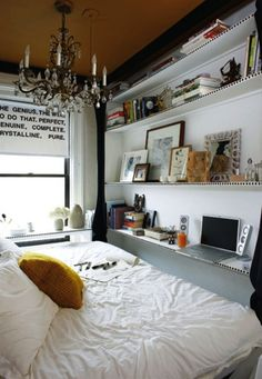 Who knew such a small bedroom could be such an inviting place? By use of shelving and multiuse (the bed seems to work as both a bed and a desk chair) what would be unlivable space for some people becomes a truly wonderful room.