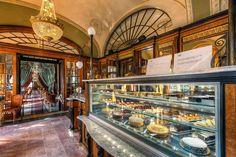 Gerbeaud Cukr�szda (Caf� Gerbeaud) | 29 Places That Prove Budapest Is The Most Stunning City In Europe---One of the biggest cafés in Hungary, the Gerbaud Café serves delicious coffee, rich chocolate, and delectable treats in lavish rooms of marble and dark-grain wood.