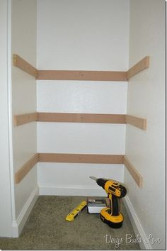 7 simple steps to create cheap easy built in closet storage, cleaning tips, closet, diy, shelving ideas, storage ideas, Third I used my drill and screwed each support piece to the wall So each shelf had three supports a piece