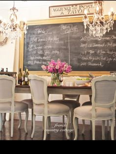 I love the butcher block table and the French provincial chairs upholstered and repainted. This is simple and elegant