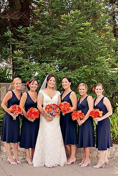 This is what I was thinking. The color part, anyway. Blue bridesmaid dresses, orange flowers, off white wedding dress with some blue in it (or not).